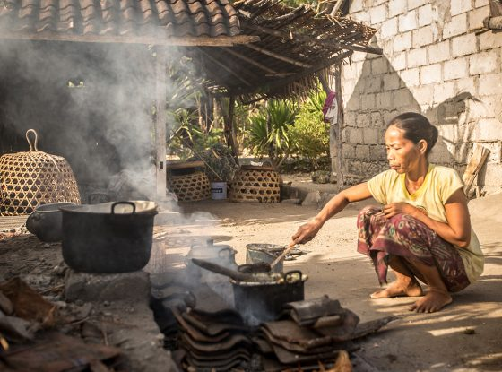 Domestic lifestyle of a Balinese woman doing outdoor cooking